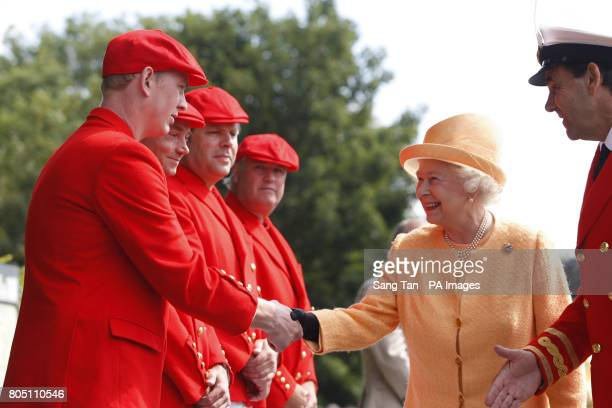 Queen Elizabeth II meets her team of Swan Uppers as she arrives at Boveney Lock near Windsor England to watch the swan upping census