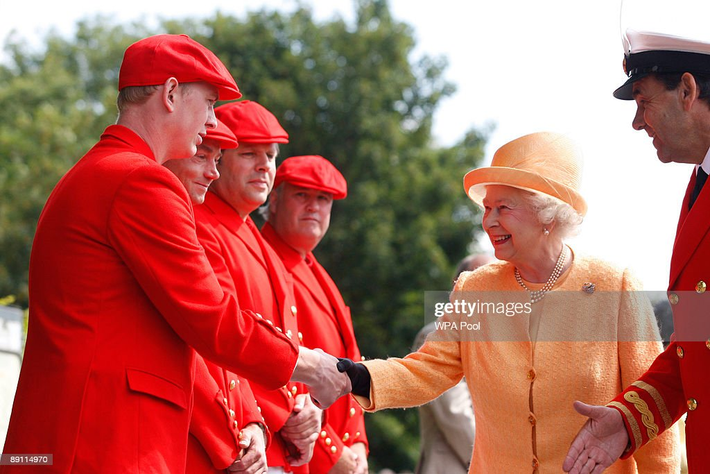 Queen Elizabeth II meets her team of Swan Uppers as she arrives at Boveney Lock to board the steam launch 'Alaska' to watch the swan upping census on the River Thames on July 20, 2009 near Windsor, England. During the ancient annual ceremony the Swan Marker leads a team of Swan Uppers on a five-day journey along the River Thames from Sunbury-on-Thames through Windsor to Abingdon counting, marking and checking the health of all unmarked swans.