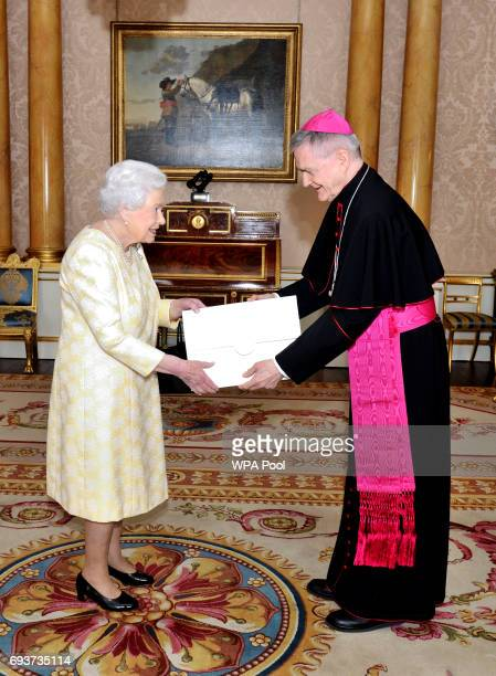 Queen Elizabeth II meets His Excellency Archbishop Edward Joseph Adams Apostolic nuncio during a private audience in Buckingham Palace on June 8 2017...
