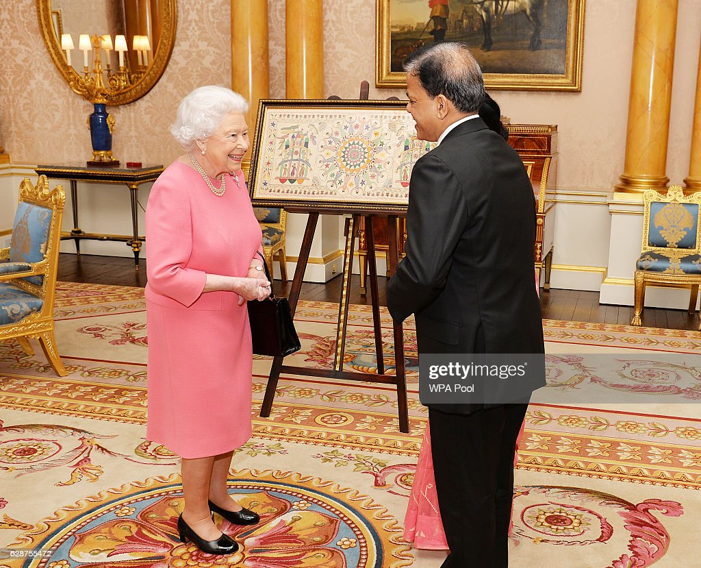 Queen Elizabeth II meets His Excellency Mr Md Nazmul Quaunine, the High Commissioner of Bangladesh who was accompanied by his wife Mrs Quaunine, as he presents his Letters of Commission, at a private audience with Her Majesty in Buckingham Palace on December 9, 2016 in London, England.