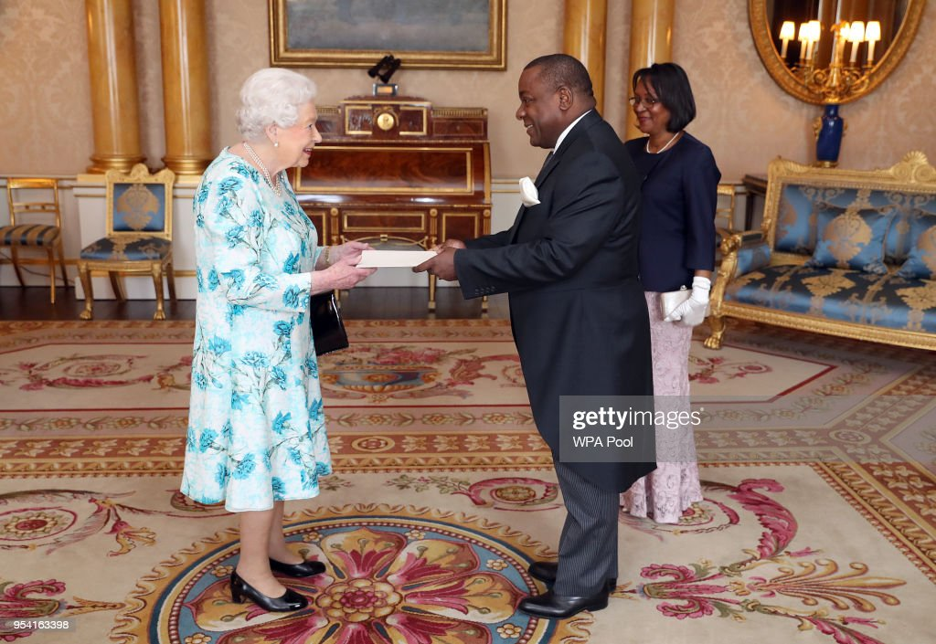 Queen Elizabeth II meets His Excellency, Mr Rui Jorge Carneiro Mangueira, the Ambassador from the Republic of Angola, as he presents his Letters of Credence with his wife, Mrs Maria Silvina Caetano (right), during a private audience at Buckingham Palace on May 3, 2018 In London, England.