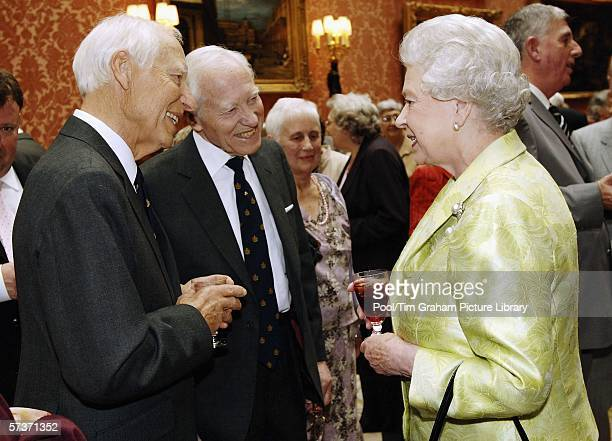 Queen Elizabeth II meets identical twins Keith and Jack Hurst at an 80th birthday lunch April 19, 2006 in London, England. The lunch is held by The...