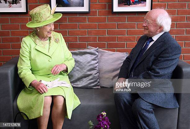 Queen Elizabeth II meets Irish President Michael D Higgins during a visit to the Lyric Theatre on June 27 2012 in Belfast Northern Ireland During the...