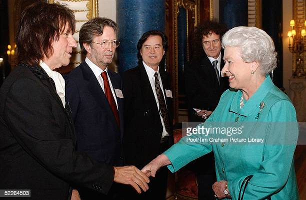 Queen Elizabeth II meets legendary guitarists Jeff Beck Eric Clapton Jimmy Page and Brian May at the Music Day At The Palace event at Buckingham...