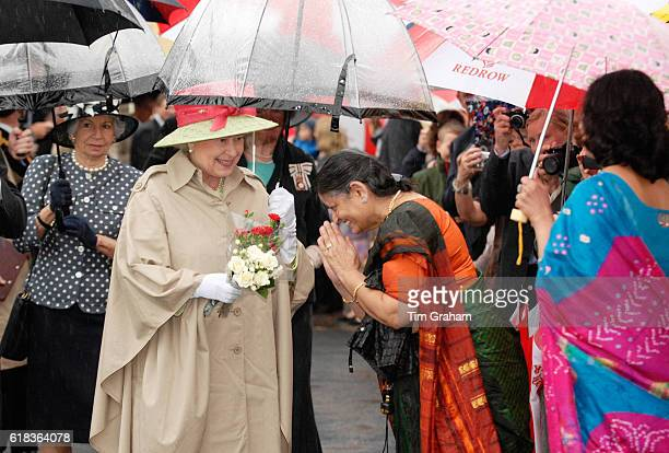 Queen Elizabeth II meets local wellwishers during a visit to the reconstructed seafront area of Knightstone Island in WestonSuperMare