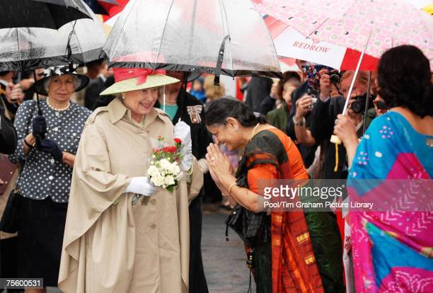 Queen Elizabeth II meets local wellwishers during a visit to the reconstructed seafront area of Knightstone Island on July 20 2007 in WestonSuperMare...