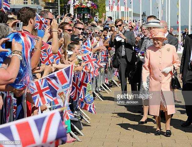 Queen Elizabeth II meets locals during her Diamond Jubilee visit to the Isle of Wight on July 25 2012 in Cowes England The Queen and Duke of...