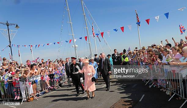 Queen Elizabeth II meets locals during her Diamond Jubilee visit to the Isle of Wight on July 25, 2012 in Cowes, England. The Queen and Duke of...