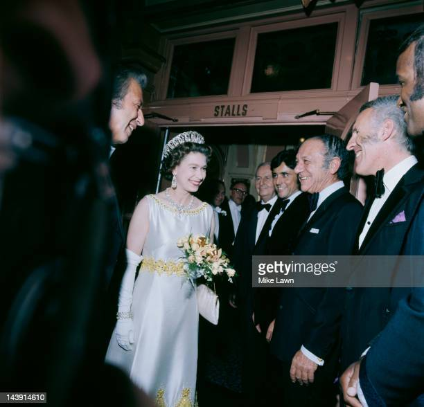 Queen Elizabeth II meets Lovelace Watkins, Bruce Forsyth, Sid James, and Sacha Distel backstage at the Royal Variety Performance, held at the London...