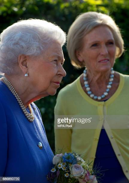 Queen Elizabeth II meets Mary Berry at the BBC Radio 2 Garden at the RHS Chelsea Flower Show press day at Royal Hospital Chelsea on May 22 2017 in...