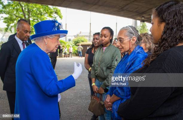 Queen Elizabeth II meets members of the community affected by the fire at Grenfell Tower in west London during a visit to the Westway Sports Centre...