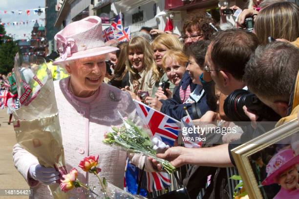 Queen Elizabeth II meets members of the public at Worcester Cathedral on July 11 2012 in Worcester England The visit is part of the Queen and Duke of...