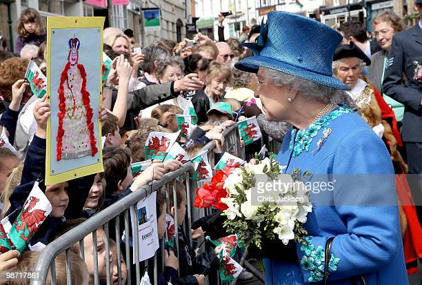 Queen Elizabeth II meets members of the public in Welshpool town centre on April 28 2010 in Welshpool Wales The Queen and Duke of Edinburgh are on a...