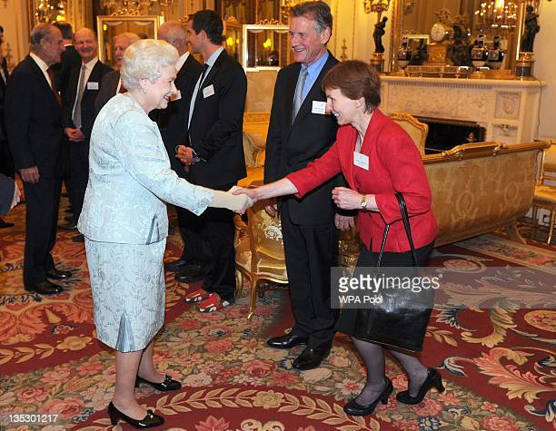 Queen Elizabeth II meets Michael Palin and Dr Helen Sharman as the Queen and Duke of Edinburgh host a reception to celebrate exploration and...