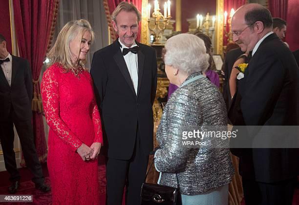 Queen Elizabeth II meets Mike Rutherford and his wife Angie Rutherford at a reception to mark the 80th anniversary of Diabetes UK at St James's...