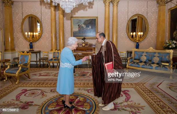 Queen Elizabeth II meets Mr Nabil Ben Khedher Ambassador of Tunisia during a private audience at Buckingham Palace on December 14 2017 in London...