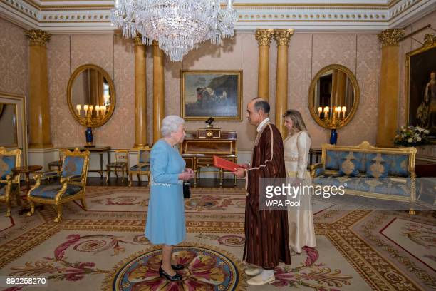 Queen Elizabeth II meets Mr Nabil Ben Khedher Ambassador of Tunisia and Mrs Maha Ben Larbi during a private audience at Buckingham Palace on December...