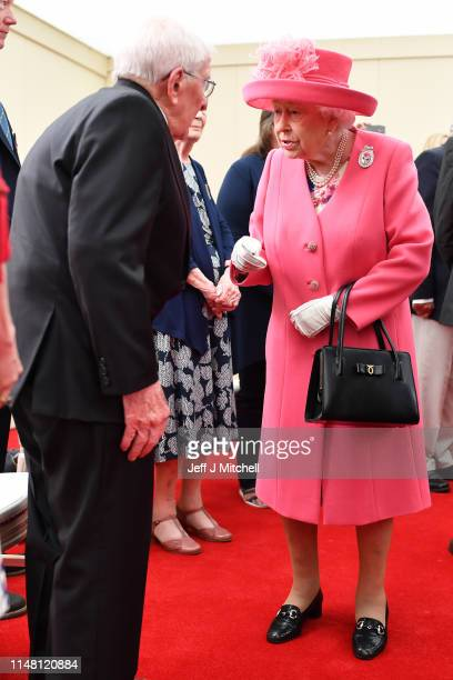 Queen Elizabeth II meets Navy veteran Thomas Cuthbert aged 93 during the Dday 75 Commemorations on June 05 2019 in Portsmouth England The political...