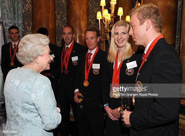Queen Elizabeth II meets Olympic gold medalists Chris Hoy and Rebecca Adlington and sailor Paul Goodison during a reception hosted by Queen Elizabeth...