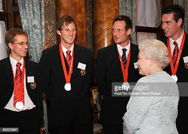 Queen Elizabeth II meets Olympic medalists from the men's 8 rowing team including cox Acer Nethercott Alastair Heathcote and Richard Egington during...