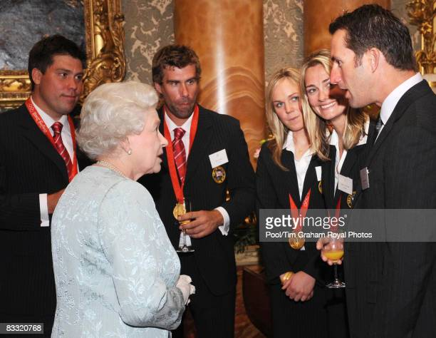 Queen Elizabeth II meets Olympic medalists sailors Andrew Simpson Iain Percy Pippa Wilson Sarah Webb and Ben Ainslie during a reception hosted by...