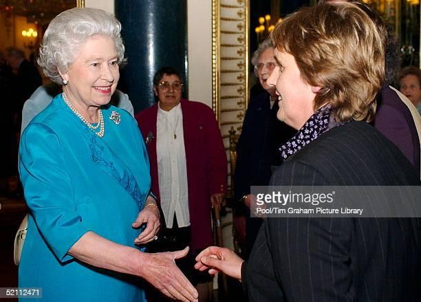 Queen Elizabeth II Meets Pauline Beare At A Cancer Research Uk Reception At Buckingham Palace.