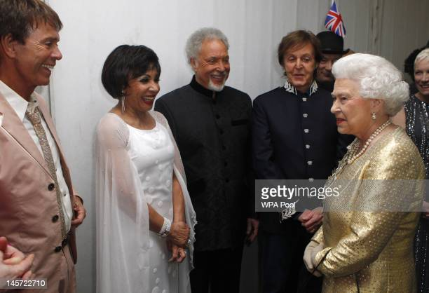 Queen Elizabeth II meets performers Sir Cliff Richard Dame Shirley Bassey Sir Tom Jones and Sir Paul McCartney backstage after the Diamond Jubilee...