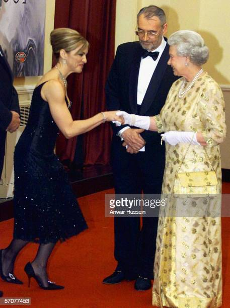 Queen Elizabeth II meets pop star and actress Madonna watched by producer Michael Wilson at the world premiere of the James Bond movie Die Another...