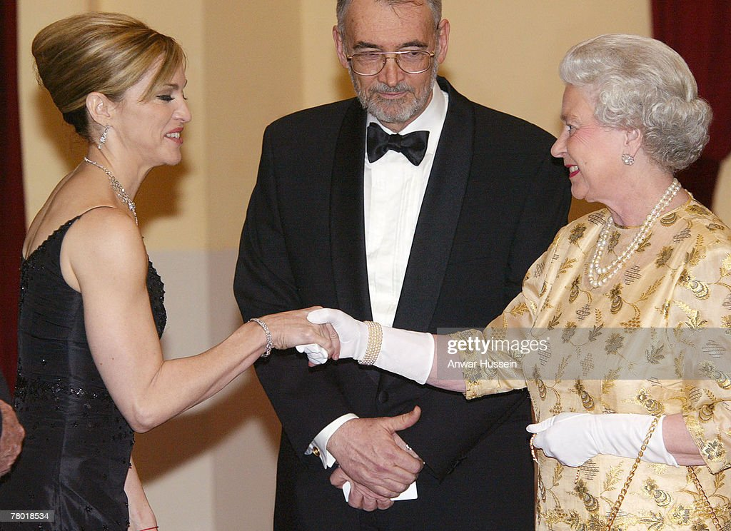 HRH Queen Elizabeth II meets pop star Madonna (L) watched by producer Michael Wilson at the World premiere of Bond movie 'Die another Day' at London's Albert Hall on November 18th, 2002.