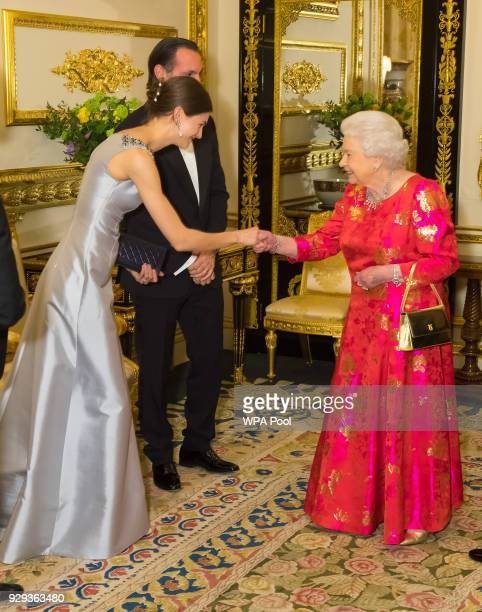 Queen Elizabeth II meets Princess Salwa Aga Khan prior to dinner at Windsor Castle on March 8 2018 in Windsor England Queen Elizabeth II is hosting...