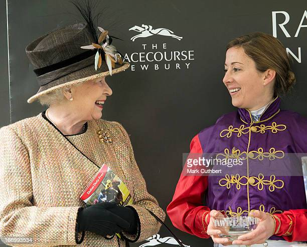 Queen Elizabeth II meets rider Hayley Turner who rode her horse Sign Manual in the The Dreweatts Handicap Stakes race to victory as she attends The...