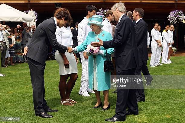 Queen Elizabeth II meets Roger Federer, Serena Williams, Novak Djokovic, Andy Roddick, Venus Williams and Caroline Wozniacki as she attends the...