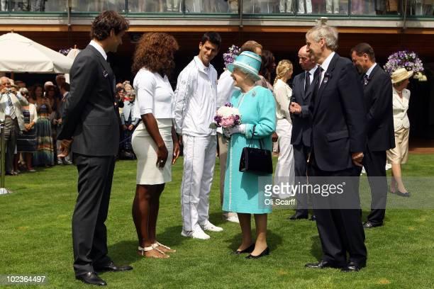Queen Elizabeth II meets Roger Federer, Serena Williams, Novak Djokovic, Andy Roddick, Venus Williams and Caroline Wozniacki as she attends the...