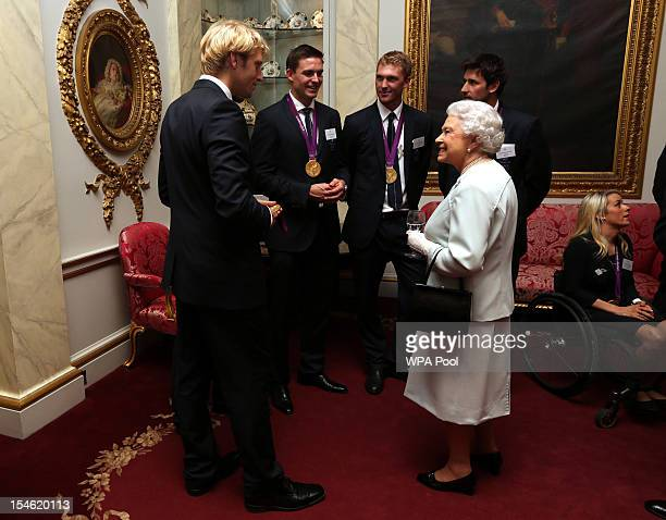 Queen Elizabeth II meets rowers Andrew TriggsHodge Pete Reed Alex Gregory and Tom James during a reception for the Team GB Olympic and Paralympic...