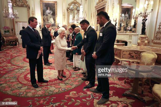 Queen Elizabeth II meets rugby players Mako and Billy Vunipola at a reception to celebrate the Commonwealth Diaspora community in the lead up to the...