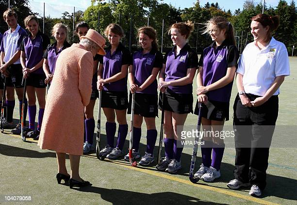 Queen Elizabeth II meets school children after a game of hockey during a visit to Gordonstoun School, where she opened a new sports hall, on...
