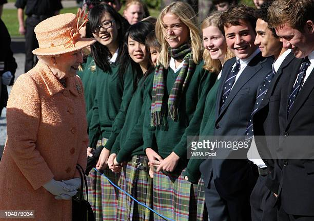Queen Elizabeth II meets school children during a visit to Gordonstoun School, where she opened a new sports hall, on September 14, 2010 in Moray,...