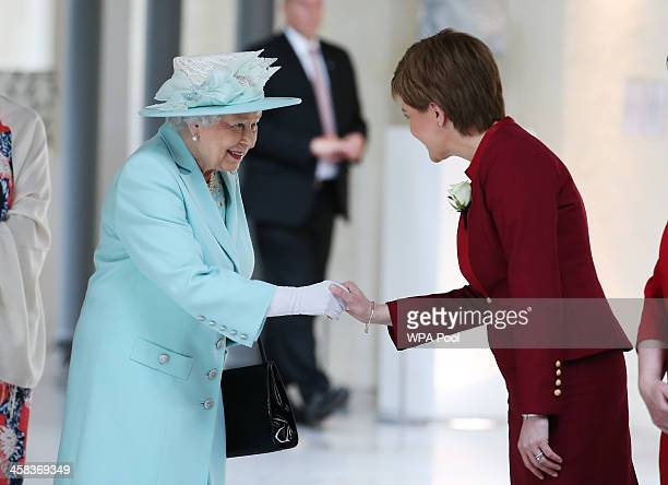 Queen Elizabeth II meets Scottish First Minister and SNP leader Nicola Sturgeon as she attends the opening of the fifth session of the Scottish...