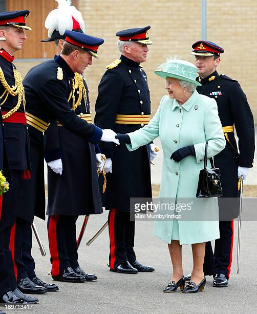 Queen Elizabeth II meets senior officers as she arrives for a visit to The King's Troop Royal Horse Artillery unit at Woolwich Barracks on May 31...