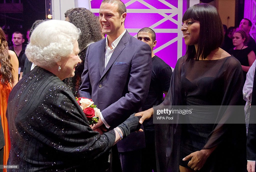 Queen Elizabeth II meets singer Alexandra Burke following the Royal Variety Performance on December 7, 2009 in Blackpool, England