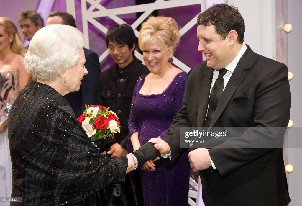 Queen Elizabeth II meets singer Bette Midler and comedian Peter Kay following the Royal Variety Performance on December 7, 2009 in Blackpool, England