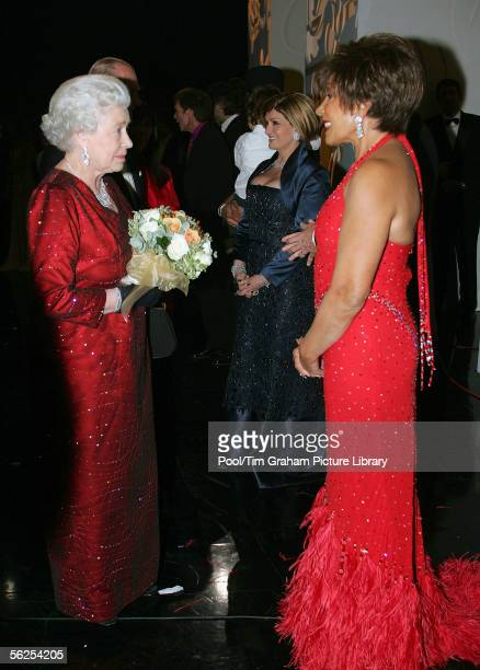 Queen Elizabeth II meets singer Dame Shirley Bassey backstage following the Royal Variety Performance, November 21, 2005 in Cardiff, Wales.