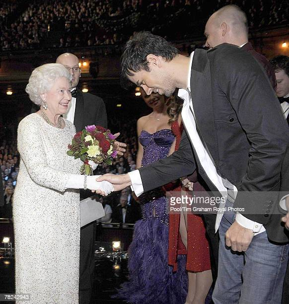 Queen Elizabeth II meets singer Enrique Iglesias after the Royal Variety Performance at the Empire Theatre on Dec. 3, 2007 in Liverpool, England.