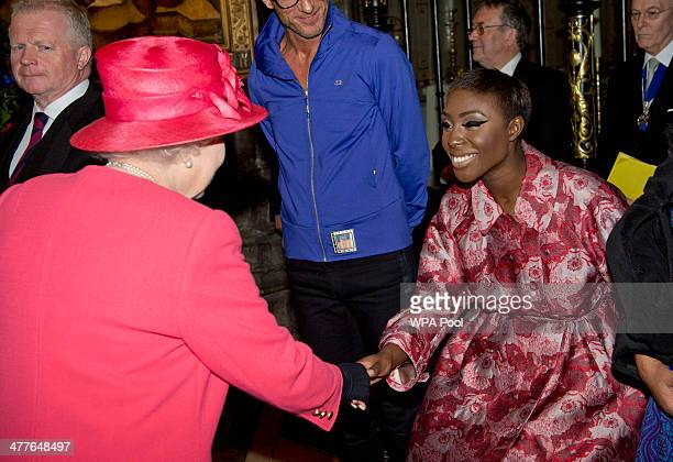 Queen Elizabeth II meets singer Laura Mvula as they attend the Commonwealth day observance service at Westminster Abbey on March 10 2014 in London...