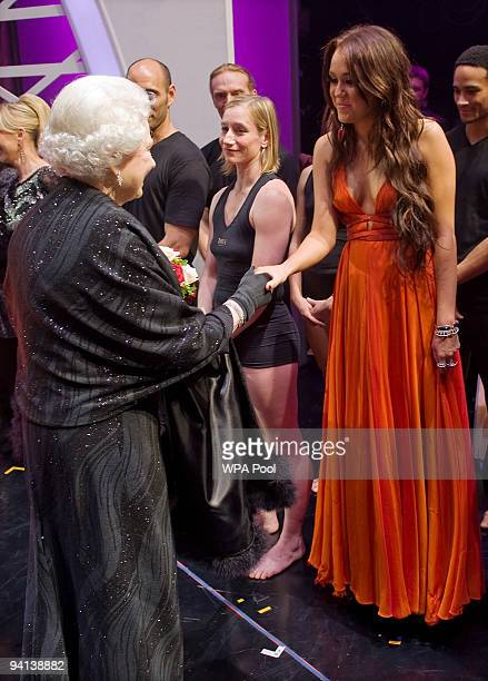 Queen Elizabeth II meets singer Miley Cyrus following the Royal Variety Performance on December 7 2009 in Blackpool England
