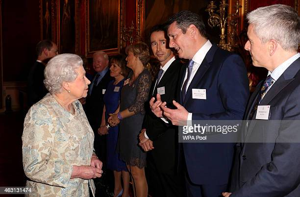 Queen Elizabeth II meets singer Tony Hadley Vice President of Shooting Star Chase during her reception to celebrate the patronages affiliations of...