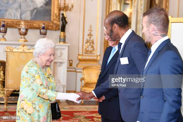 Queen Elizabeth II meets Sir Lenny Henry at Buckingham Palace on June 26 2018 in London England The Queen's Young Leaders Programme now in its fourth...