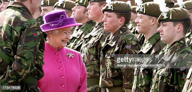 Queen Elizabeth II meets soldiers of the 2nd Battalion The Royal Welsh Regiment and presents leeks to the men in celebration of St David's Day at the...