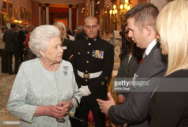 Queen Elizabeth II meets Staff Sergeant Kim Hughes holder of the George Cross at a reception for the Victoria Cross and George Cross Association at...