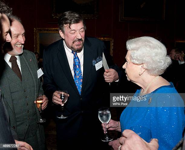Queen Elizabeth II meets Steven Fry during the Dramatic Arts reception at Buckingham Palace on February 17 2014 in London England
